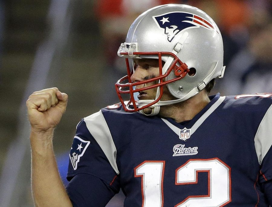 New England Patriots quarterback Tom Brady celebrates a touchdown by running back Stevan Ridley against the Cincinnati Bengals in the first quarter of an NFL football game Sunday, Oct. 5, 2014, in Foxborough, Mass. (AP Photo/Steven Senne)