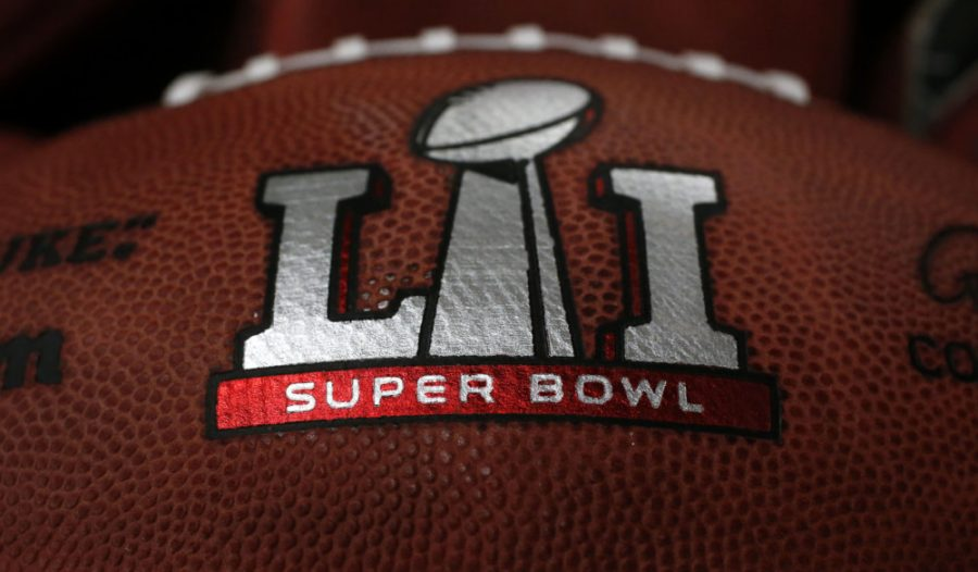 The+first+NFL+Super+Bowl+LI+football+sits+in+a+bin+with+other+balls+to+be+stamped+with+the+New+England+Patriots+and+Atlanta+Falcons+names+at+the+Wilson+Sporting+Goods+factory+Sunday%2C+Jan.+22%2C+2017%2C+in+Ada%2C+Ohio.+%28AP+Photo%2FCharles+Rex+Arbogast%29