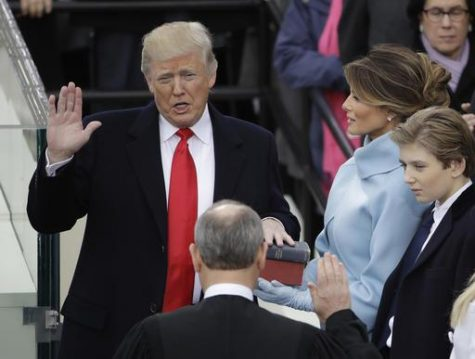 Donald Trump is sworn in as the 45th president of the United States by Chief Justice John Roberts as Melania Trump looks on during the 58th Presidential Inauguration at the U.S. Capitol in Washington, Friday, Jan. 20, 2017. (AP Photo/Matt Rourke) `