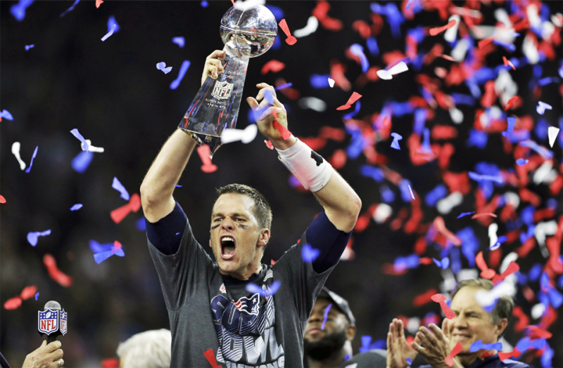 New England Patriots' Tom Brady raises the Vince Lombardi Trophy after defeating the Atlanta Falcons in overtime at the NFL Super Bowl 51 football game Sunday, Feb. 5, 2017, in Houston. The Patriots defeated the Falcons 34-28. (AP Photo/Darron Cummings)