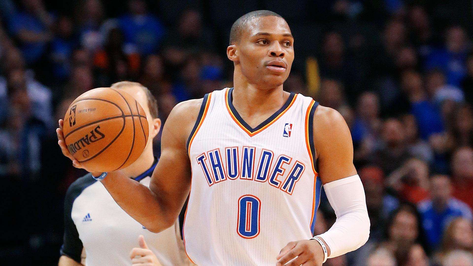Oklahoma City Thunder guard Russell Westbrook (0) brings the ball up the court in the fourth quarter of an NBA basketball game against the Orlando Magic in Oklahoma City, Sunday, Dec. 15, 2013. Oklahoma City won 101-98. (AP Photo/Sue Ogrocki)