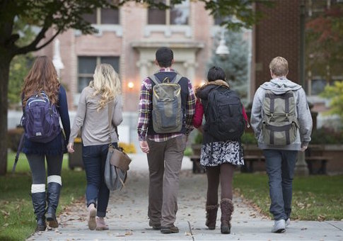 College students walking on campus (Blend Images via AP Images)