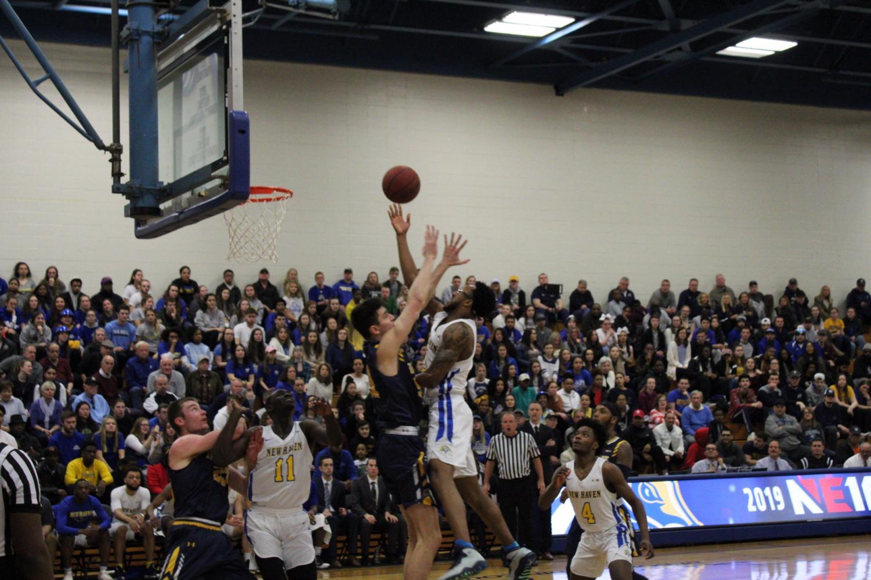 Junior Elijah Bailey goes up against Merrimack in NE-10 Final: Photo Courtesy Anthony Gangemi