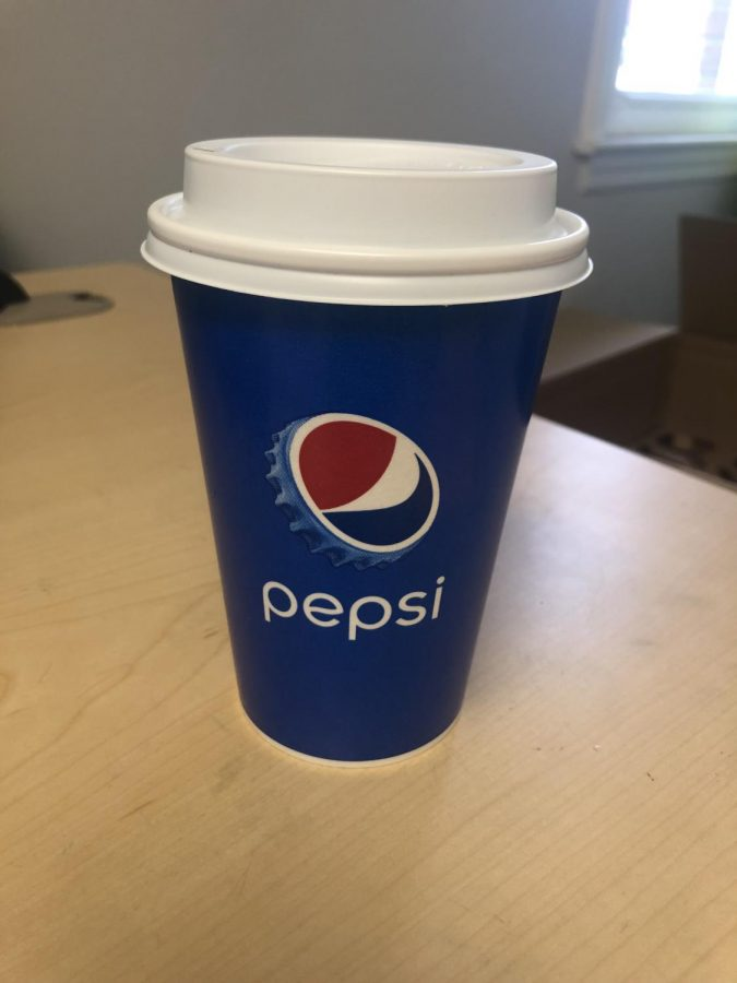 Instead of straws and traditional lids, students can use coffee top lids.