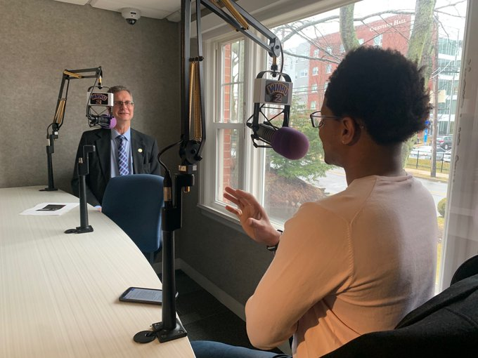Associate Dean for the College of Arts and Sciences recording the first taping of the