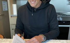 Tom Brady signing his contract to the Tampa Bay Buccaneers.