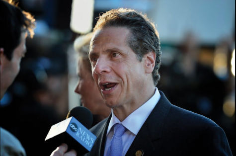 Andrew Cuomo speaking to an interviewer at Belmont Stakes