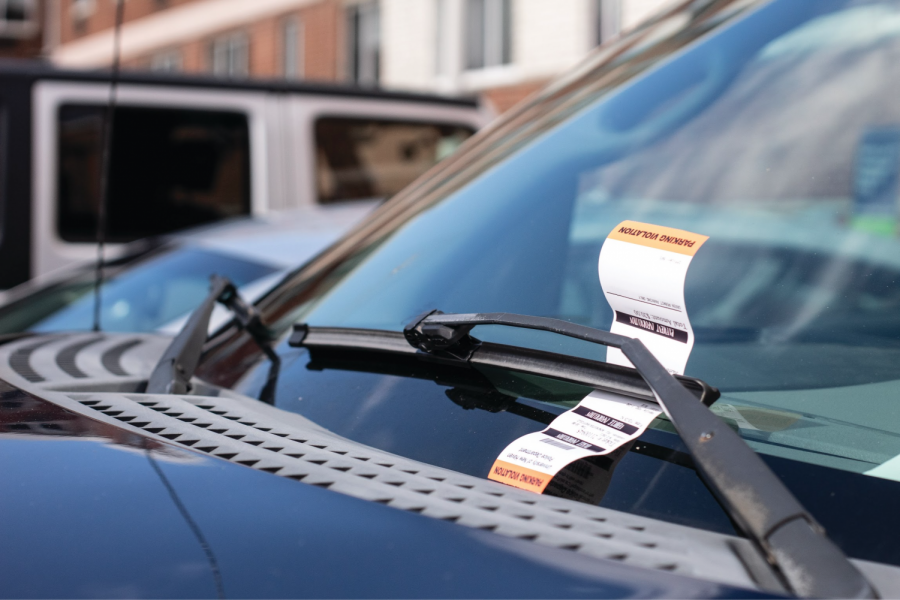 A car receives a parking ticket outside of Winchester Hall, West Haven, CT.