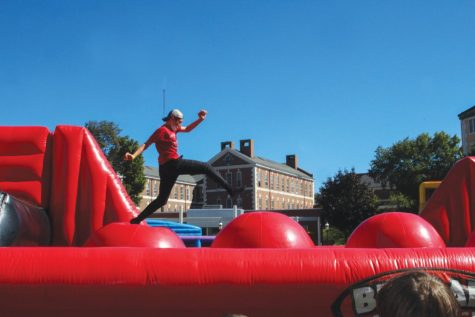 A student runs across an inflatable s at at Family Day, West Haven, Sept. 25, 2021