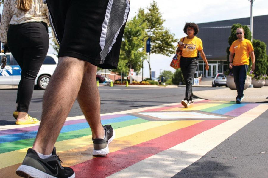 Students walk across the newly installed Pride crosswalk outside of Maxcy Hall