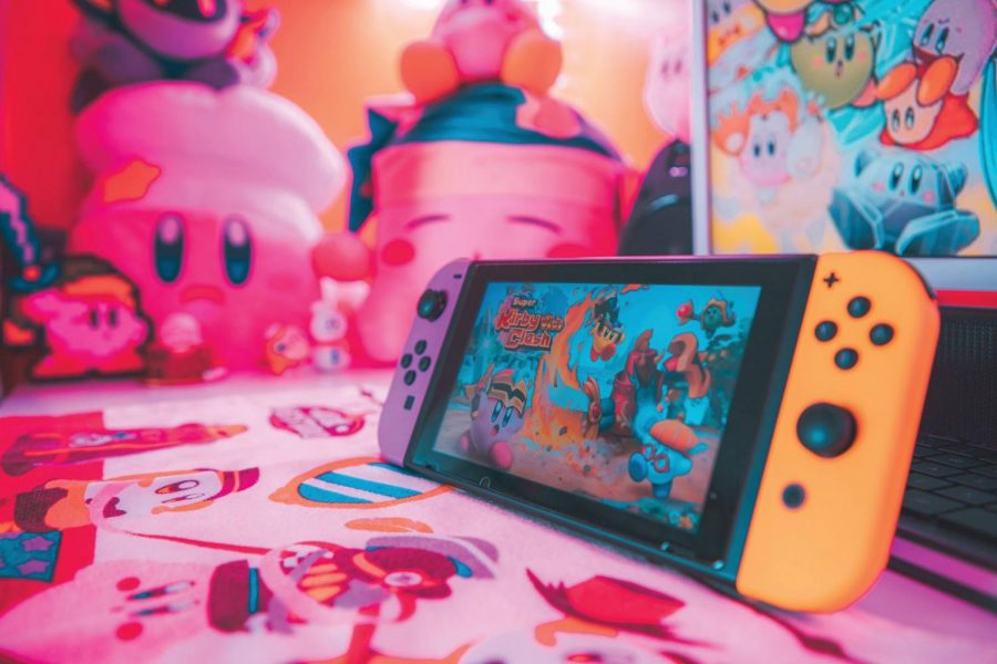 Super Kirby Clash being played on a Nintendo Switch