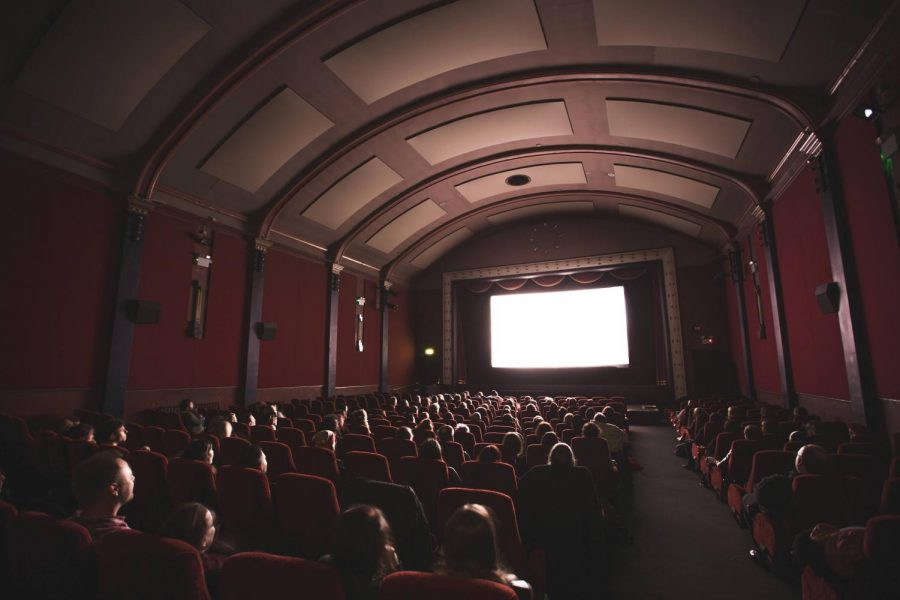 Inside a crowded movie theater.