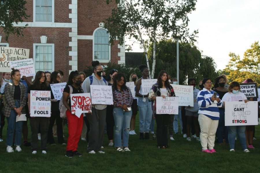Protesters gather outside of Maxcy Hall and hold signs, West Haven, Sept. 20, 2021.