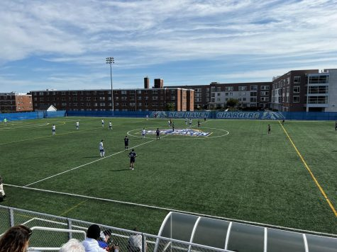 Mens soccer players on the Kathy Zolad Stadium field