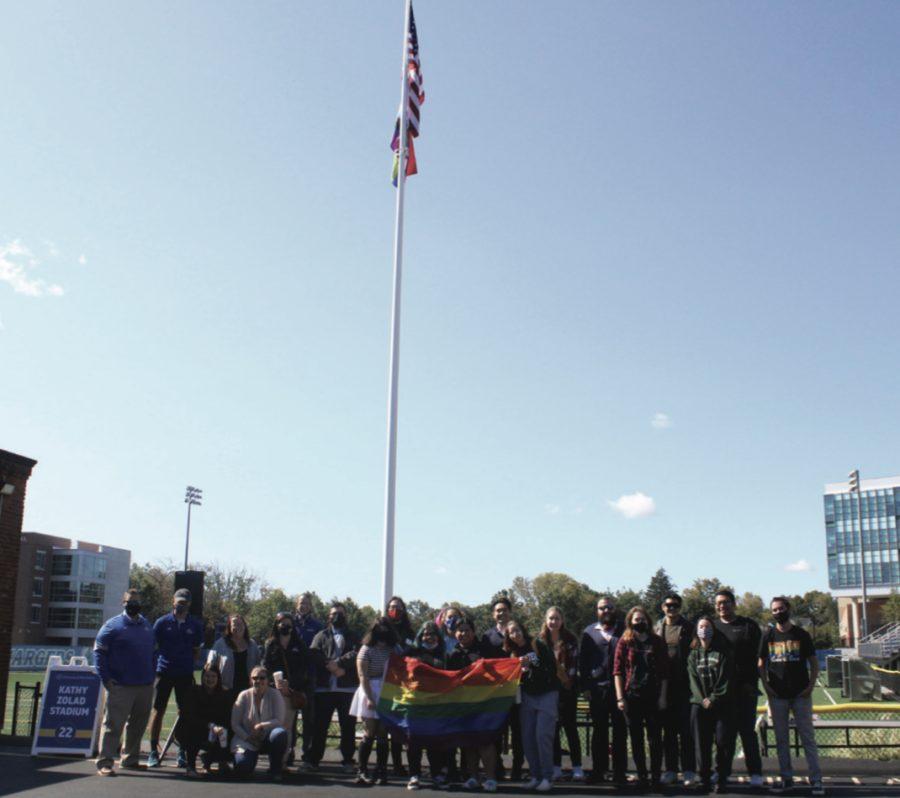 Members of university community celebrate flag raising, Oct. 1, West Haven